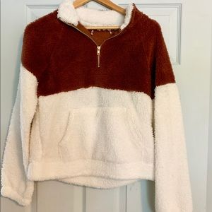 Brown and white pullover